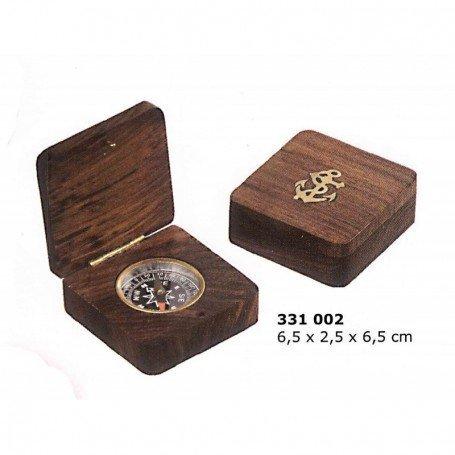 Brújula pequeña encastada en caja de madera